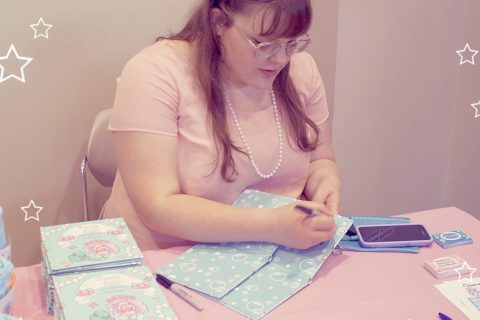 Author/Illustrator Amber Heaton signing 'Pearls for Pearl'.