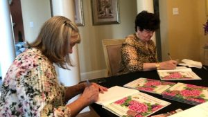 Author, Nancy Rust, and the woman behind the story, Peggy Martin, signing 'The Rose Without a Name'.